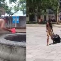 Joven mujer se baña en fuente y pasea desnuda en zócalo de Oaxaca